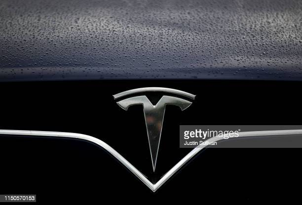 The Tesla logo is displayed on the front of a Tesla car on May 20, 2019 in Corte Madera, California. Stock for electric car maker Tesla fell to a...