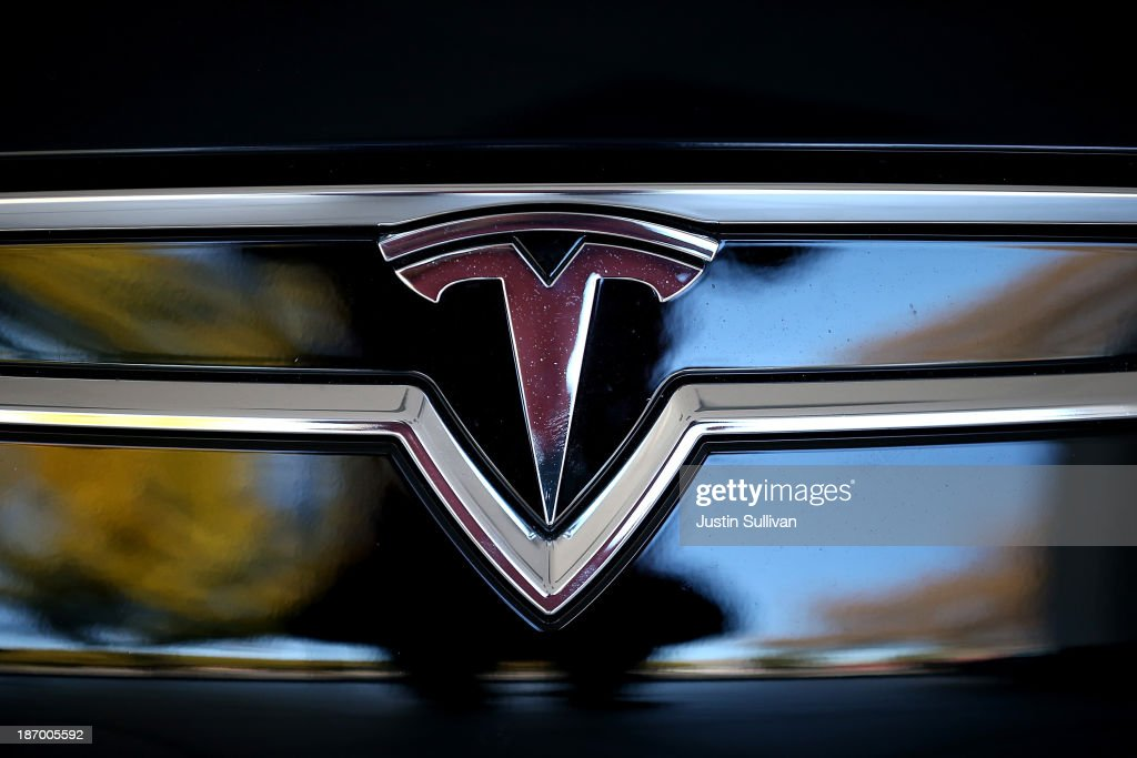 The Tesla logo is shown on the front of a new Tesla Model S car at a Tesla showroom on November 5, 2013 in Palo Alto, California. Tesla will report third quarter earnings today after the closing bell.