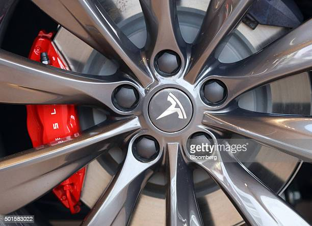 The Tesla logos sits in the center of a wheel on a Tesla Model S P90D automobile inside the Tesla Motors Inc showroom at a dealership on Oxford...