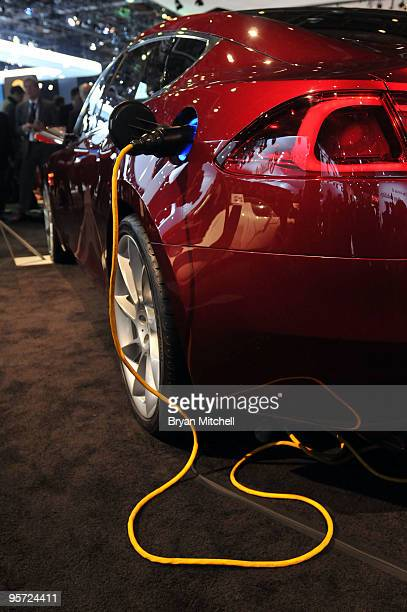 The Tesla Model S electric vehicle seen plugged in on the show floor during the press preview for the world automotive press at North American...