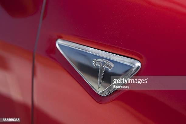 The Tesla Motors Inc logo is displayed on a Model 3 vehicle outside the company's Gigafactory in Sparks Neveada US on Tuesday July 26 2016 Tesla...