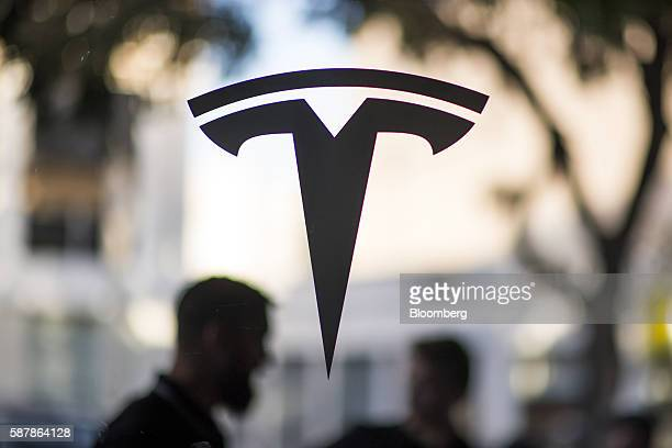 The Tesla Motors Inc logo is displayed on a window at the company's new showroom in San Francisco California US on Tuesday Aug 9 2016 Tesla marked...
