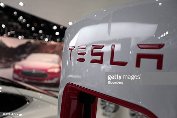 The Tesla Motors Inc logo is seen on a charging station at the company's booth during the 2014 North American International Auto Show in Detroit...