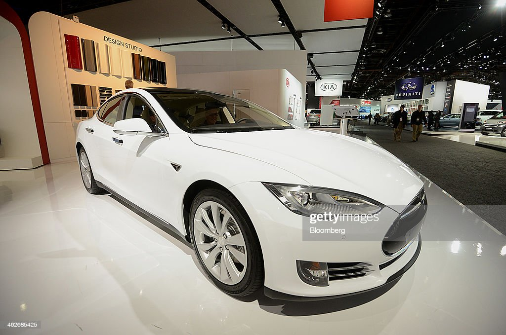 The Tesla Motors Inc. Model S sedan is displayed during the 2014 North American International Auto Show (NAIAS) in Detroit, Michigan, U.S., on Tuesday, Jan. 14, 2014. Tesla Motors Inc., the maker of high-end electric cars, gained the most in six weeks after the carmaker said it delivered 6,900 Model S sedans in the fourth quarter, pushing full-year sales beyond a company target. Photographer: Daniel Acker/Bloomberg via Getty Images