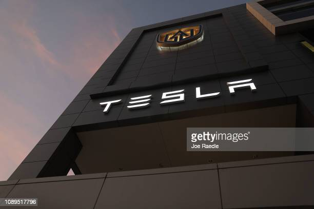 The Tesla name is seen on the exterior of a dealership on January 03 2019 in Miami Florida Tesla Inc shares have fallen as the company reported...