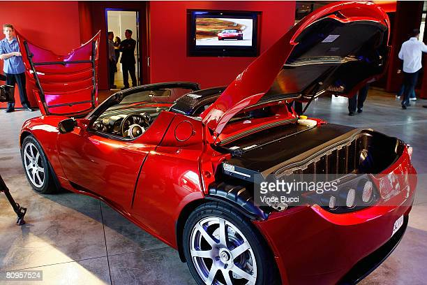 The Tesla Roadster the world's first highwaycapable all electric car available in the United States is displayed on its production debut in the Tesla...