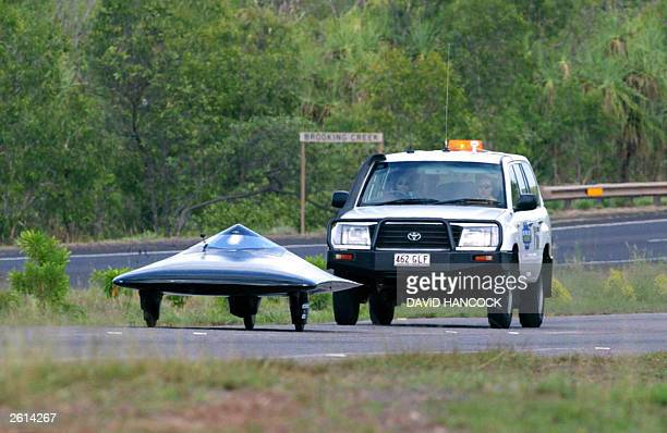 """The """"Tesseract"""" solar car, from Massechussets Institute of Technology of USA, heads of Darwin towards Adelaide in the World Solar Challenge,19..."""