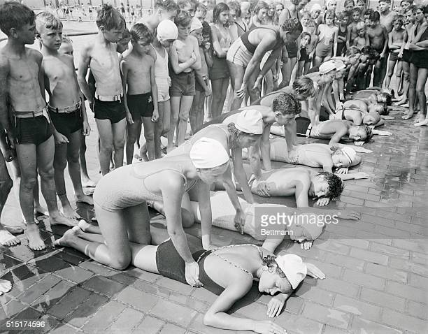 FORMER OLYMPIC SWIM STAR GIVES A FINAL TEST The test in this case being one in resuscitation of partially drowned persons Miss Ethel McGary former...