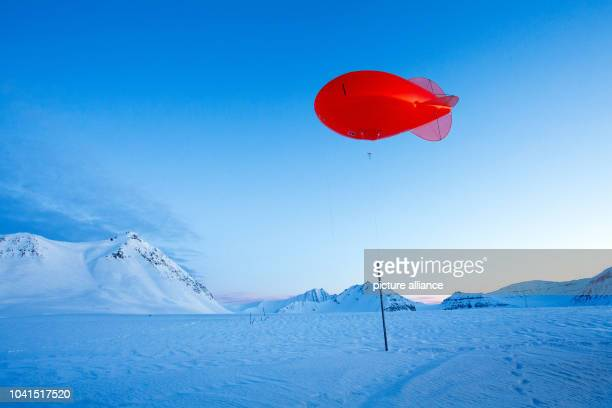 The tethered balloon at Atmospheric Obervatory of the AWIPEV Arctic Research Base can be seen on Spitsbergen in NyAelesund Norway 09 April 2015 The...