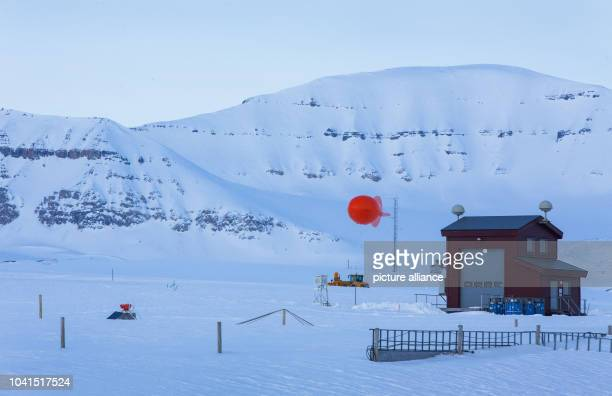 The tethered balloon at Atmospheric Obervatory of the AWIPEV Arctic Research Base can be seen on Spitsbergen in NyAelesund Norway 10 April 2015 The...