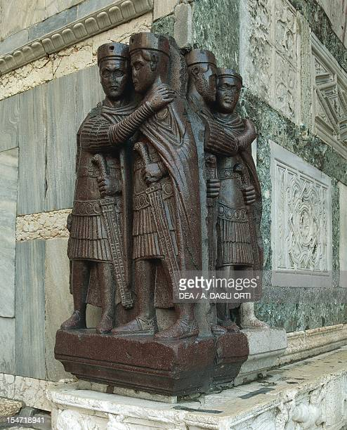The tetrarchs porphyry group sculpture SyrianEgyptian art 4th century located in the southern corner of the Treasury St Mark's Basilica Venice Italy