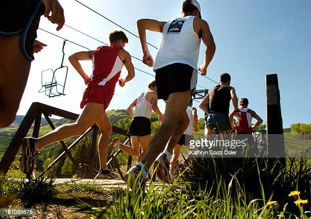 The Teva Mountain Games in Vail, CO. Runners make their way across a small bridge at the beginning of the USA 10km Trail Running Championships.