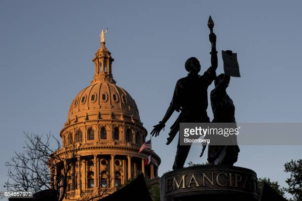 The Texas AfricanAmerican History Memorial right and the Texas State Capitol building stand in Austin Texas US on Tuesday March 14 2017 Austin has...