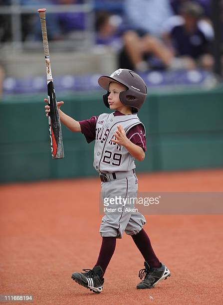 The Texas AM Aggies bat boy take a bat to the dugout during a game against the Kansas State Wildcats on April 3 2011 at Tointon Stadium in Manhattan...