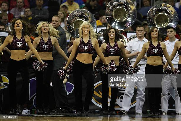 The Texas AM Aggies cheerleaders dance on the sidelines during the game against the Iowa State Cyclones on day 1 of the Big 12 Men's Basketball...