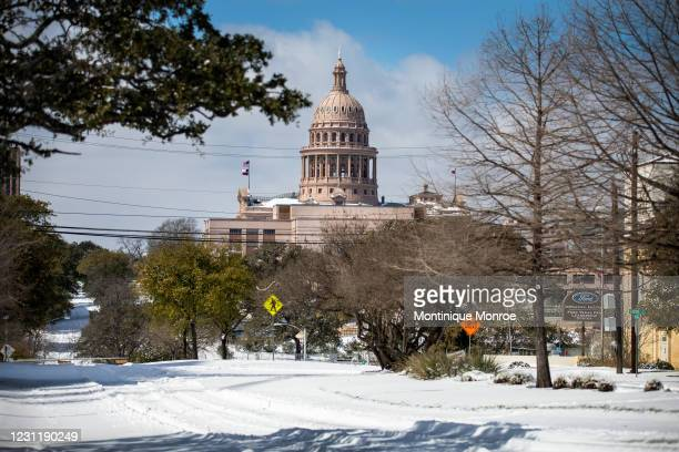 The Texas Capitol is surrounded by snow in on February 15, 2021 in Austin, Texas. Winter storm Uri has brought historic cold weather to Texas,...