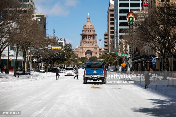 The Texas Capitol is surrounded by snow on February 15, 2021 in Austin, Texas. Winter storm Uri has brought historic cold weather to Texas, causing...