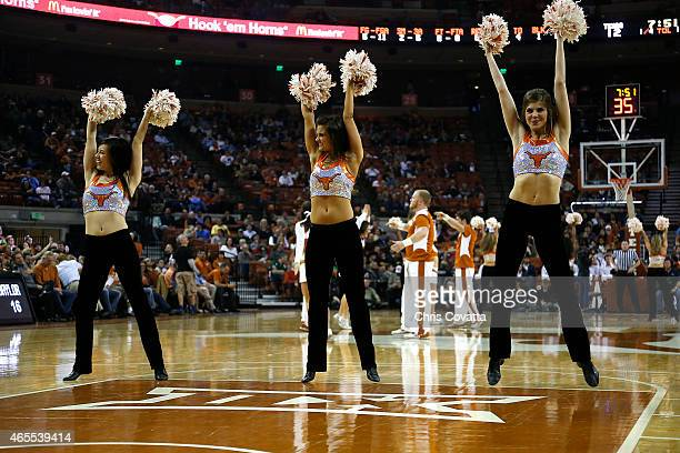The Texas cheerleaders perform during the game between the Texas Longhorns and the Baylor Bears at the Frank Erwin Center on March 2 2015 in Austin...