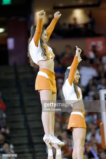 The Texas cheerleaders perform during the game between the Texas Longhorns and the Michigan Wolverines at the Frank Erwin Center on December 12 2017...