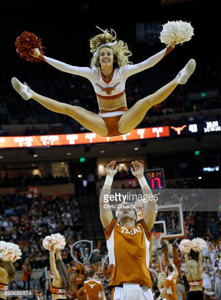 The Texas cheerleaders perform during the game between the Texas Longhorns and the Kansas Jayhawks at the Frank Erwin Center on December 29 2017 in...