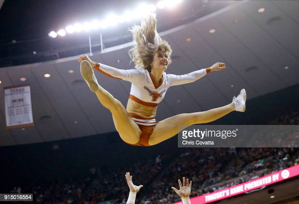 The Texas cheerleaders perform during the game between the Texas Longhorns and the Oklahoma Sooners at the Frank Erwin Center on February 3 2018 in...
