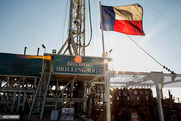 The Texas flag flies at Endeavor Energy Resources LP's Big Dog Drilling Rig 22 in the Permian basin outside of Midland, Texas, U.S., on Friday, Dec....