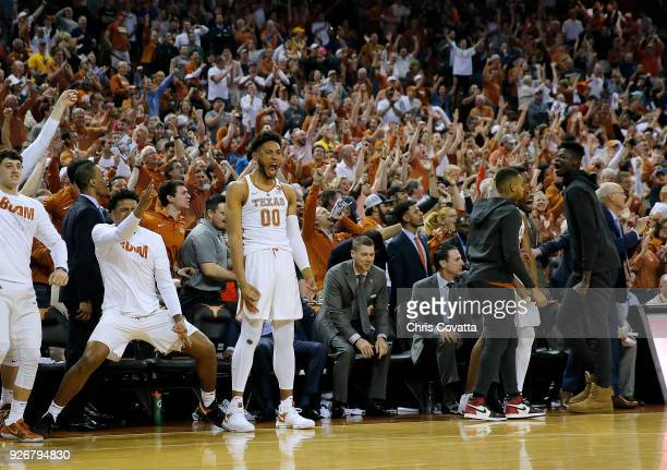 The Texas Longhorns bench reacts as the Texas Longhorns defeated the West Virginia Mountaineers 8779 in overtime at the Frank Erwin Center on March 3...