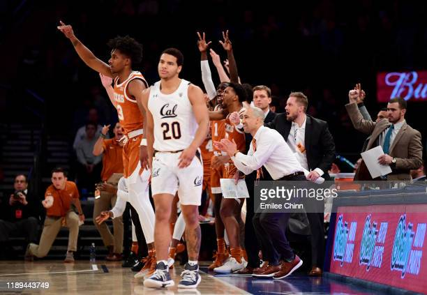 The Texas Longhorns celebrate a three pointer by Courtney Ramey as Matt Bradley of the California Golden Bears looks on during the second half of...