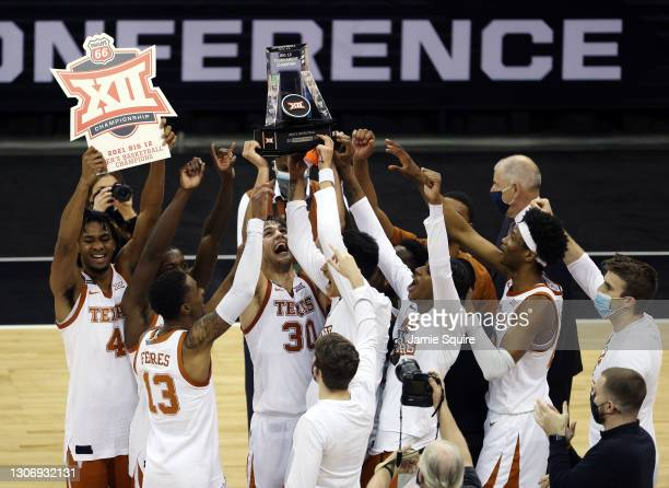 The Texas Longhorns celebrate after defeating the Oklahoma State Cowboys 91-86 to win the Big 12 Basketball Tournament championship game at the...