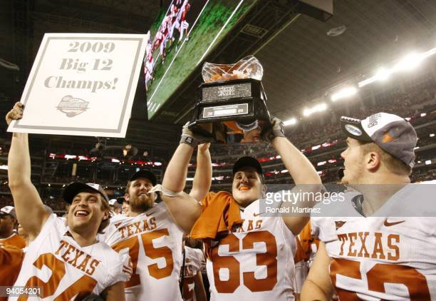 The Texas Longhorns celebrate their 106 victory over the Nebraska Cornhuskers in the game at Cowboys Stadium on December 5 2009 in Arlington Texas