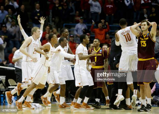 The Texas Longhorns celebrate their 87 to 85 win over the Arizona State Sun Devils in the second round of the 2014 NCAA Men's Basketball Tournament...