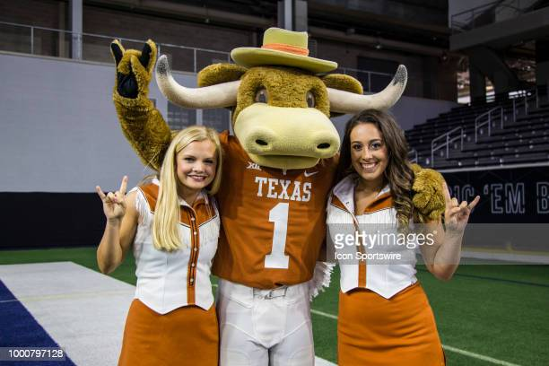 The Texas Longhorns cheerleaders and mascot pose for a picture during the Big 12 Media days on July 17 2018 at the Ford Center at The Star in Frisco...