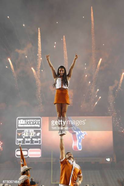 The Texas Longhorns cheerleaders perform during a firework presentation after the game against the Kansas Jayhawks at Darrell K RoyalTexas Memorial...