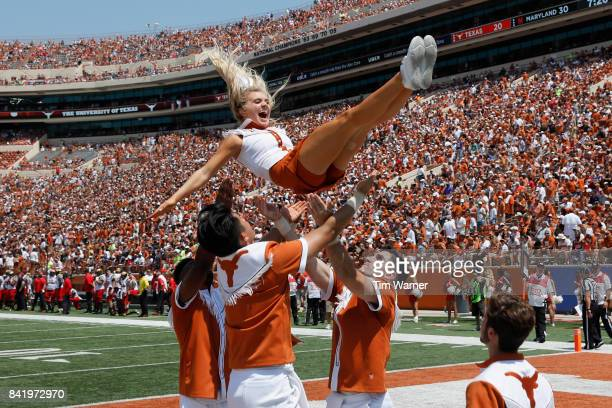 The Texas Longhorns cheerleaders perform during the game against the Maryland Terrapins at Darrell K RoyalTexas Memorial Stadium on September 2 2017...