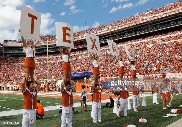 The Texas Longhorns cheerleaders perform during the game against the Oklahoma State Cowboys at Darrell K RoyalTexas Memorial Stadium on October 21...
