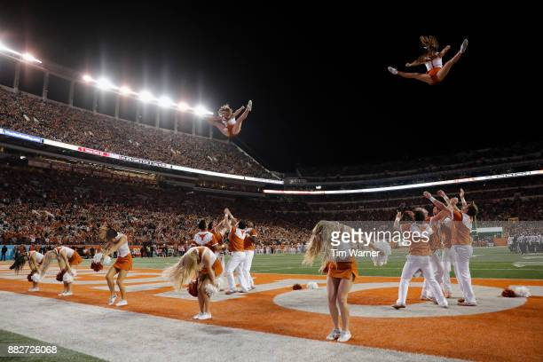 The Texas Longhorns cheerleaders perform during the game against the Texas Tech Red Raiders at Darrell K RoyalTexas Memorial Stadium on November 24...