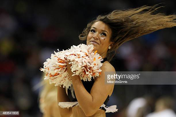 The Texas Longhorns cheerleaders perform in the second half against the Arizona State Sun Devils during the game at BMO Harris Bradley Center on...