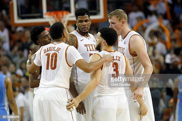 The Texas Longhorns huddle up during the game with the North Carolina Tar Heels at the Frank Erwin Center on December 12 2015 in Austin Texas