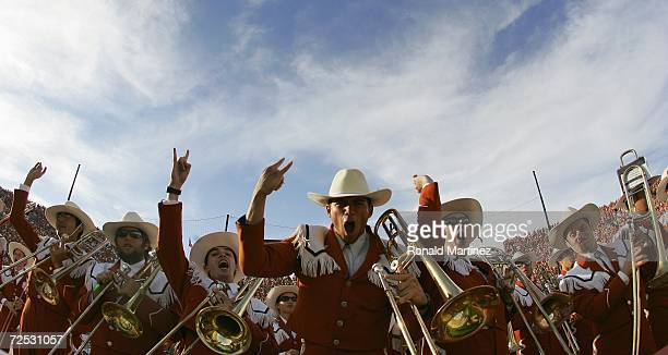 The Texas Longhorns marching band hold up the Hook 'em Horns sign during the Red River Shootout against the Oklahoma Sooners at the Cotton Bowl on...