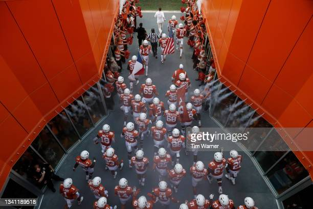 The Texas Longhorns run out of the tunnel before the game against the Rice Owls at Darrell K Royal-Texas Memorial Stadium on September 18, 2021 in...