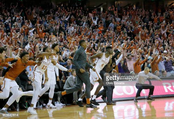 The Texas Longhorns rush the court after defeating the TCU Horned Frogs in double overtime 9998 at the Frank Erwin Center on January 10 2018 in...