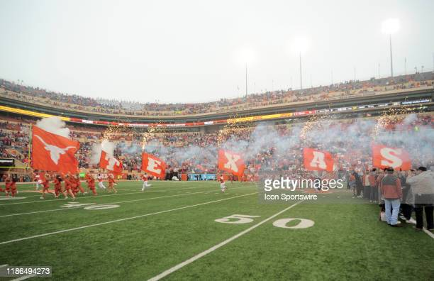 The Texas Longhorns spirit squad leads out the team prior to game against the Texas Tech Red Raiders on November 29 2019 at Darrell K RoyalTexas...