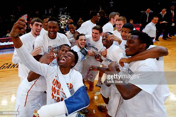 The Texas Longhorns take a selfie after defeating the California Golden Bears at Madison Square Garden on November 21 2014 in New York City The...