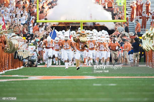 The Texas Longhorns take the field before kickoff against the Rice Owls on September 12 2015 at Darrell K RoyalTexas Memorial Stadium in Austin Texas