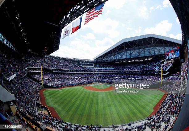 The Texas Rangers and the Toronto Blue Jays stand during the National Anthem on Opening Day at Globe Life Field on April 05, 2021 in Arlington, Texas.