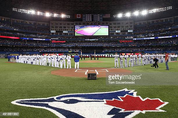 The Texas Rangers and the Toronto Blue Jays stand for the national anthem prior to game one of the American League Division Series at Rogers Centre...