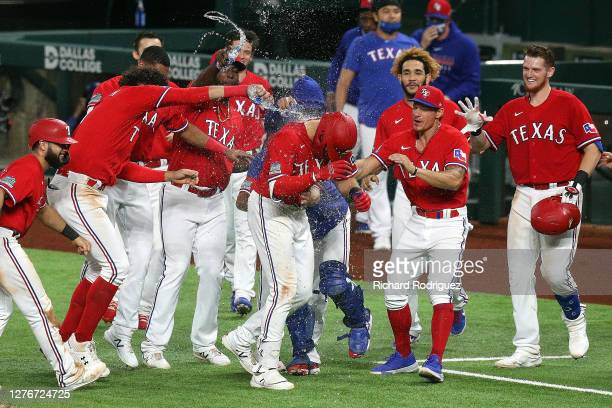 The Texas Rangers celebrate the win over the Houston Astros after a walk off single by Joey Gallo of the Texas Rangers that scored Isiah Kiner-Falefa...