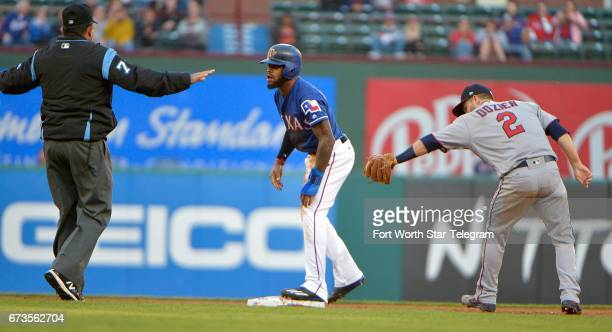 The Texas Rangers' Delino DeShields steals second base as Minnesota Twins second baseman Brian Dozier can't make the tag at Globe Life Park in...