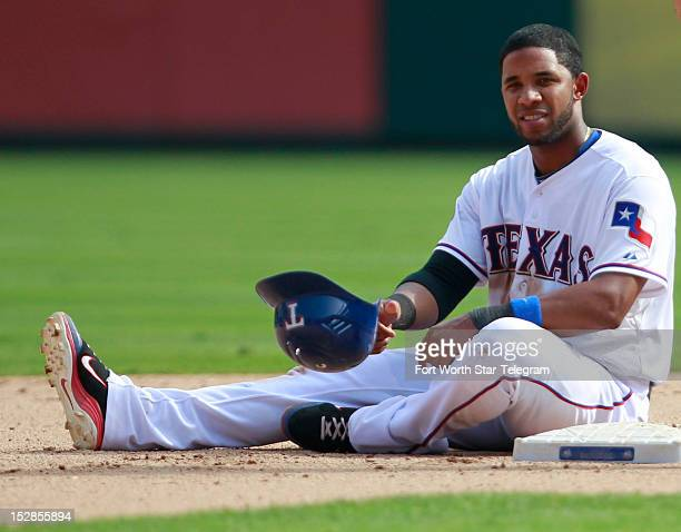 The Texas Rangers' Elvis Andrus sits on second base after being thrown out on a fielder's choice in the eighth inning against the Oakland Athletics...