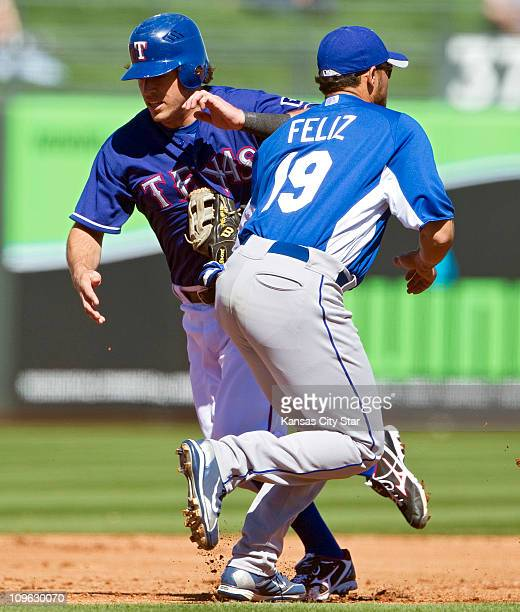 The Texas Rangers' Ian Kinsler left gets tagged out on a rundown by Kansas City Royals third baseman Pedro Feliz in the first inning of a spring...